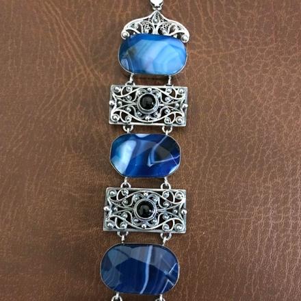 браслет +с синими камнями