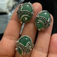 Сережки  с зеленым камнем