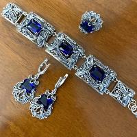 серебряные серьги +с синим камнем