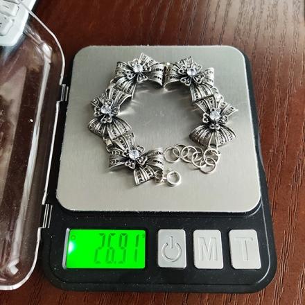 серебряный браслет  с  бантиками