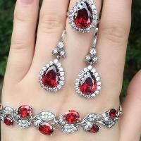 Серьги +кольцо с красными камнями