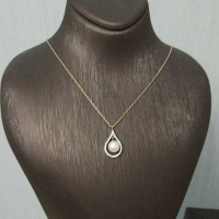 Золотое колье  с жемчугом и бриллиантами