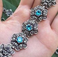 серебряный браслет +с голубым камнем