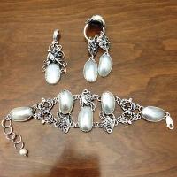 серебряные комплекты +с камнями фото +и цены